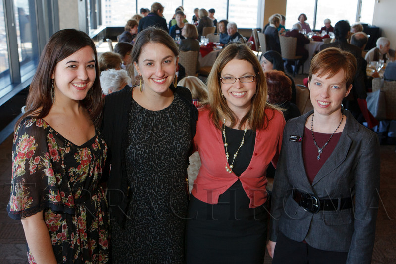Melissa Muscato, Amy Baum, Brooke Chandler, and Samantha Teter (CS director of marketing and sales).  Luncheon hosted by the Colorado Symphony, introducing the Women of Note fundraising initiative, at the Pinnacle Club at the Grand Hyatt Denver in Denver, Colorado, on Friday, Dec. 16, 2011.<br /> Photo Steve Peterson