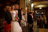 Mikaela Hutchison and her grandparents, Janie and Buck Hutchison, have a formal photo taken on the steps in the Brown Palace lobby.  The 56th Annual Denver Debutante Ball at the Brown Palace Hotel & Spa in Denver, Colorado, on Thursday, Dec. 22, 2011.<br /> Photo Steve Peterson