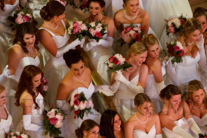 Debutantes ham it up after the strictly formal photo is taken.  The 56th Annual Denver Debutante Ball at the Brown Palace Hotel & Spa in Denver, Colorado, on Thursday, Dec. 22, 2011.<br /> Photo Steve Peterson