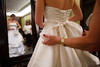 Lizzie Larson's lacing and bow are finished by Eileen Morton.  The 56th Annual Denver Debutante Ball at the Brown Palace Hotel & Spa in Denver, Colorado, on Thursday, Dec. 22, 2011.<br /> Photo Steve Peterson