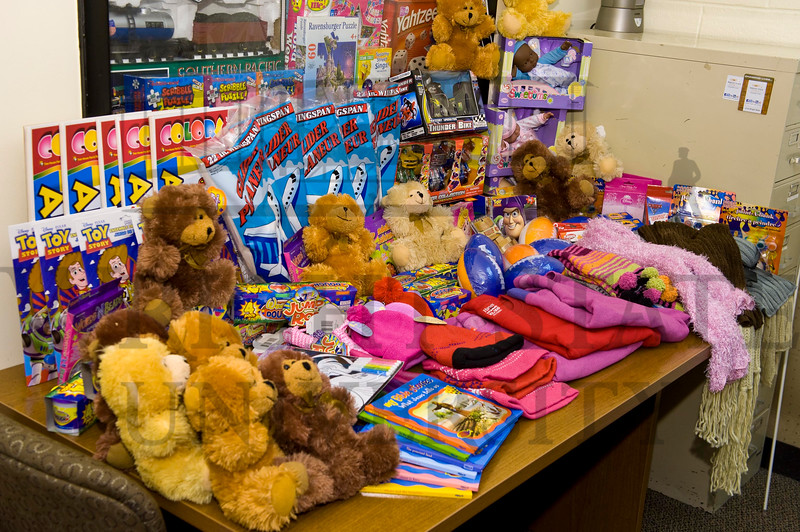 Holiday Toy Donation and check presentation to Beth Mann 12-9-11