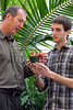 Prof. Don Cipollini and student John Ali  examine a plant in the greenhouse lab at Wright State University. <br />   © 2011 Photograph by Skip Peterson