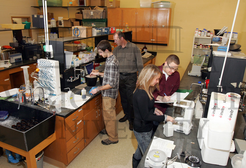 In the lab, student John Ali,left,  is with Prof. Don Cipollini and student Alex Woodward, foreground, works with student Dan Baker. <br />   © 2011 Photograph by Skip Peterson