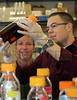 Prof. Don Cipollini and student Dan Baker, look at a sample of toxic waste in the lab at Wright State University. <br />   © 2011 Photograph by Skip Peterson