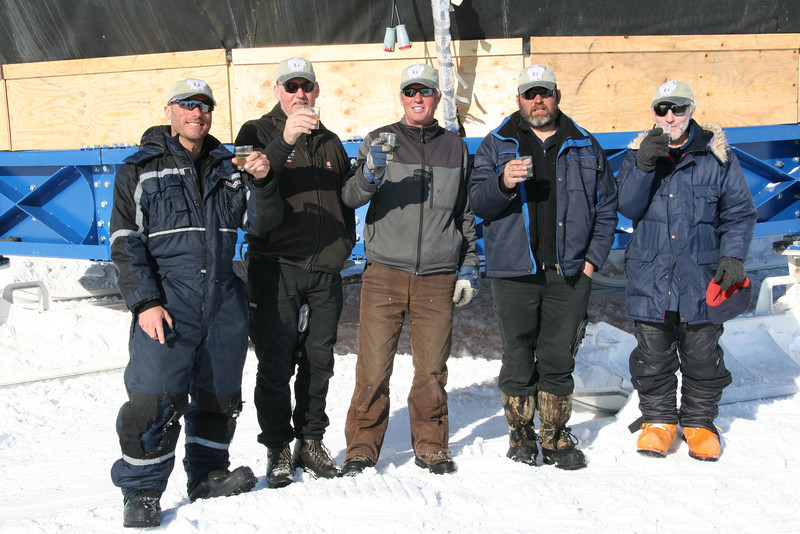 The Dome sledge mounting team celebrating that the Dome is on skies.