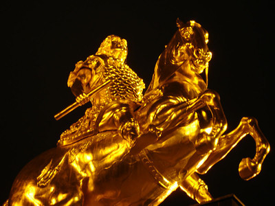 His statue is gilded with gold leaf.