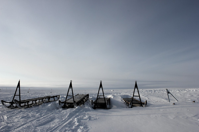 The wooden Nansen sled carries up to 1100 lbs (500 kg) and towed behind a skidoo it is used as a transporter for passengers and all kind of equipment within and outside the NEEM camp.<br /> <br /> Photo: Christian Panton