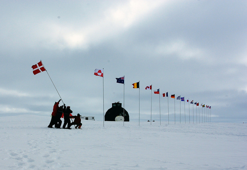 Flagline is prepared in the main street - the flag line includes the NEEM funding nations and the nationalities of the 2011 participants. Denmark and Greenland are up front as inviting countries and the other flags follow in alphabetic order of nationality according to British spellling.  <br /> <br /> Photo: Neemo Jiwa