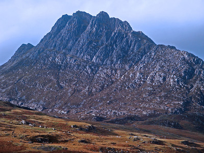 My first objective was to climb Tryfan here. Just visible on the highest point are two seven foot rock pillars named Adam and Eve, between which the insanely brave or those tired of life can attempt to jump. I had a secret ambition to iron on the top of them, but was concerned about the bad weather forecast. Although any lightning would doubtless make the experience even more special.