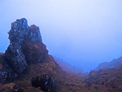 Fearsome drops descend into the mist.