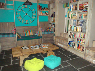 Completely knackered after an entire day of lugging my gear around the mountains in gales, I was absolutely thrilled to discover the brand new boutique 'Plas Curig' hostel in Capel Curig. This is the library.