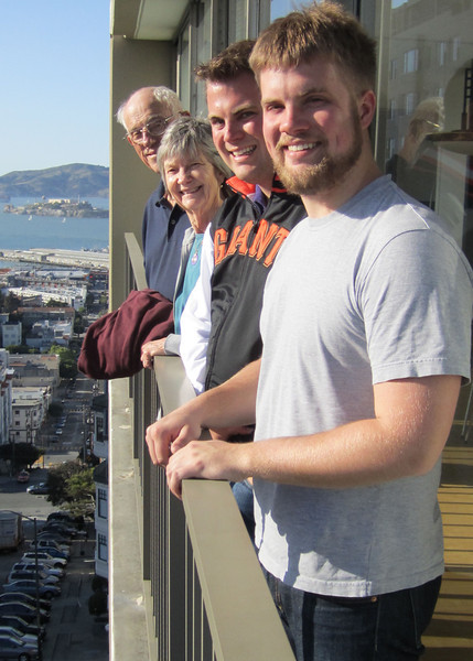 Dad, Mom, Davy and Jim at Davy's apartment in San Francisco (Alcatraz in the background)