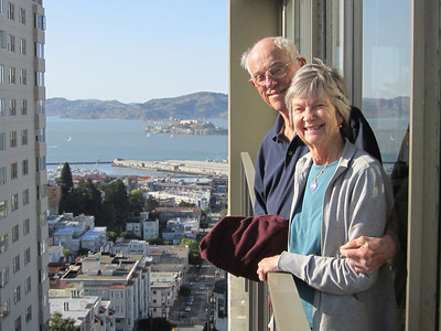 Dad and Mom at Davy's apartment in San Francisco (Alcatraz in the background)