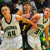 Tribune-Star/Jim Avelis<br /> Do not enter: Vikings Zach Lyon(44) and Cody Thornton(30) box out Sullivan's Kaleb Pirtle at a free throw attempt.
