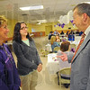 Tribune-Star/Jim Avelis<br /> Marchers: March of Dimes March for Babies volunteers Beth Callahan and Jennifer Anderson talks with board member Mick Newport before the Kickoff dinner Thursday night. This year's march will be April 30th for more information refer to their  website: Marchforbabies.org