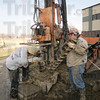 Tribune-Star/Rachel Keyes<br /> Swapping Out:  Operators Scott Smith (left) and Dennis Beaty (right) change out the drill bit on one of the rigs.