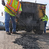 Tribune-Star/Jim Avelis<br /> On patrol: Steve Stedman, a five-year employee of the Terre Haute Street Department, fills potholes along Lafayette Avenue north of Ft. Harrison.