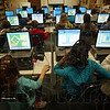 Tribune-Star/Jim Avelis<br /> Learning lab: Demoing Elementary School students involved in their ISTEP Boot Camp hone their math skills using computer games during camp Thursday afternoon.