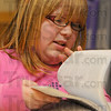 "Tribune-Star/Jim Avelis<br /> A-B-C: Ashley Miller looks through a dictionary for the meaning of a homophone in the English language skills part of her ISTEP Boot Camp experience at Deming Elementary School Thursday. Words such as ""hire"" and ""higher"" or ""clause"" and ""claws"" were used in games to build the students word usage skills."
