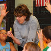 Tribune-Star/Jim Avelis<br /> I know, I know: Nicole Maples hopes to get called on for the answer during an English skills word game involving homophones. Deming Elementary School teacher Donna Tidd leads the small group of learners attending the schools' ISTEP Boot Camp.