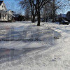 Tribune-Star/Jim Avelis<br /> Slick spot: A corner curb disappears in the snow, ice and sleet along a southside Terre Haute city street.