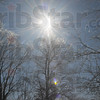 Tribune-Star/Jim Avelis<br /> Diamonds: Ice coated tree tops sparkle in the noontime sun Wednesday along Ohio Boulevard.