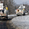 Convoy: A group of Duke Energy line vehicles from Salisbury, North Carolina travel along Fruitridge Avenue Thursday afternoon. They are enroute to a worksite in northeast Vigo County to repair power lines.