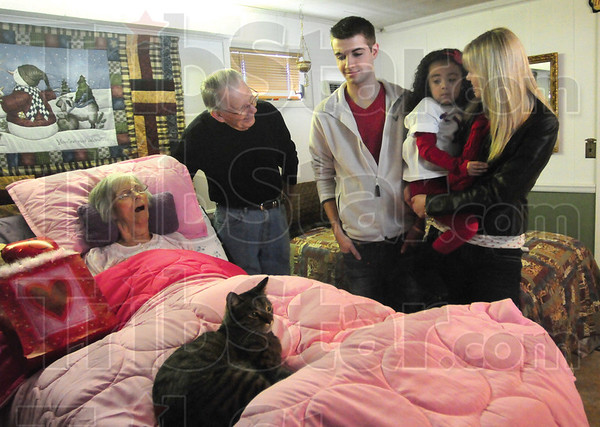 Tribune-Star/Rachel Keyes<br /> Spread the Love: Vista Care patient Darlene Neal(far left) and husband Bob Neal (left) receive a valentine from Youth Embracing Service volunteers Grant Mansard, (middle) five-year-old Zoe Valdez (right) and Amanda Mansard (far right).