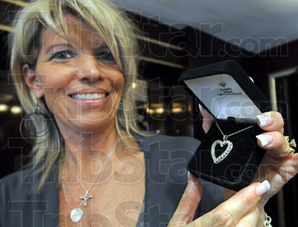 Favorite: Pam Ellis holds a diamond necklace that is a favorite among Valentine's Day buyers this year in her downtown jewelry store.