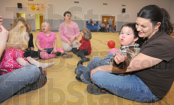Tribune-Star/Jim Avelis<br /> Together: Zeke Contreras and his mom Viola right, sit with others at the Valentine's day dance Saturday.