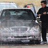 Tribune-Star/Jim Avelis<br /> Cleaning up: Enrico Ferriera rinses soap, as well as salt and dirt from his car at a self serve car wash at Wabash and Blakely late laast week.