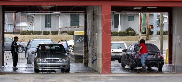 Tribune-Star/Jim Avelis<br /> While you can: Self-serve ar washes were busy late last week. Warmer temperatures gave vehicle owners a chance to wash salt and dirt from their rides. Here Enrico Ferreira spray rinses his car while Barbara Perry just starts scrubbing hers, one bay over.