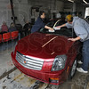 Tribune-Star/Jim Avelis<br /> Busy Business: Scotty's Hand Car Wash and Detail on Poplar Street saw a steady stream of customers Thursday. Here Dominic Ellington and John Hillenburg give a final wipe down to a car while customers visit while they wait.