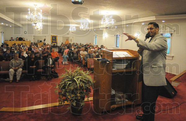 Tribune-Star/Rachel Keyes<br /> Encouraging Words: Zion hope Baptist Church Pastor Tony McGee gives some words of encouragement to the crowd gathered to remember black history.