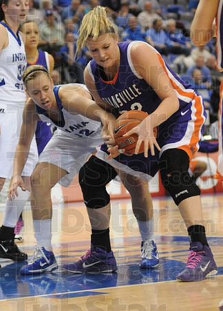 Tribune-Star/Rachel Keyes<br /> Loose Ball: Indiana State's Andrea Rademacher fights for a loose ball against Evansville's Stephanie Bamberger.