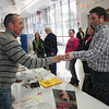 Tribune-Star/Rachel Keyes<br /> Pick My Number: John McClure Director of Advertising at the Tribune Star hands Soon to be groom Bryan Shields  his door prize. Shields and fiancé Jessica Cook are set to be wed on September 10th 2011.