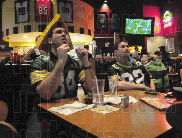 Tribune-Star/Rachel Keyes<br /> Big Cheese: Cousins Michael Alsop (right) and Adam Rice (left) cheer their team on at Buffalo Wild Wings  during first quarter action of Super Bowl.