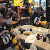 Tribune-Star/Rachel Keyes<br /> Family Affair: Die Hard Steelers fan Bob Hendricks (right) passes the tradition on to son Rob Hendricks (middle) and grandson Sean Hendricks (left) as they cheer their team on at Buffalo Wild Wings.