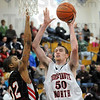 Gant inside: Justin Gant scores off an inbounds play during first half action against North Central Friday night.