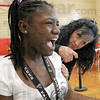Reaction: Chauncey Rose Middle School student Emonie Ford reacts to a vaccination from Regional Hospital R.N. Kelly Waters Friday afternoon in the school gym.