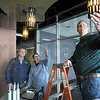 Light just right: Century 21 co-owners Rob Measel and Judi Evelo (L) work with CDI representative Greg Tucker as they prepare the former Children's Museum space for the opening of their new office.