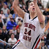 Runner: North's #24, Matt O'Leary takes the ball down the lane during first half action against Carmel Friday night.