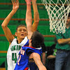 Tribune-Star/Jim Avelis<br /> Jumper: West Vigo senior Ryan Crowther shoots over the reach of Linton defender Dess Fougerousse in first quarter action Friday night.