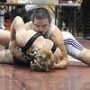 Tribune-Star/Rachel Keyes<br /> Keep Fighting: Viking's Senior Ryan Roach puts up a good fight in the IHSSA Wrestling Sectional but ultimately is defeated by Bloomington South's Clayton Fiddler.