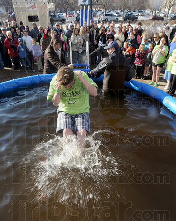 Tribune-Star/Jim Avelis<br /> Good crowd: Tammy Massey takes her plunge in front of a good sized crowd saturday morning. The Polar Plunge Special Olympics fundr raiser had dozens of participants as well as scores of onlookers.