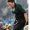 Tribune-Star/Jim Avelis<br /> Morning dip: Emma Mentley emerges from the polar plunge pool steaming in the cold morning air. She was portraying Alice from the Brady Bunch for her part in the Special Olympics fund raiser.