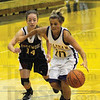 Tribune-Star/Rachel Keyes<br /> Drive In: Sullivan's point guard Jaleigh Gilham drives to the hole against Edgewood.