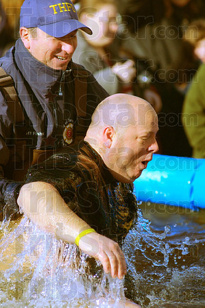 Tribune-Star/Jim Avelis<br /> Brisk: Vigo County Sheriff Greg Ewing reacts to the chilly waters of the Polar Plunge pool. He and dozens of others took the icy dip to raise money for Indiana Special Olympics. He is assisted by Terre Haute Fire chief Jeff Fisher.