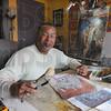 Tribune-Star/Jim Avelis<br /> Natural habitat: Edward Holloman poses for a photo in his upstairs studio.