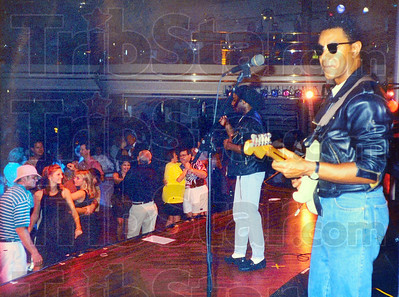 Tribune-Star submitted photo Afloat: Edward Holloman plays guitar in a band aboard a cruise ship.